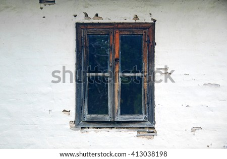 Old wooden window on old house - stock photo