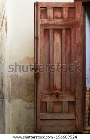 Old wooden window with antique window latch - stock photo