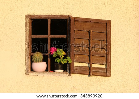 Old wooden window with shutter and iron bar. - stock photo