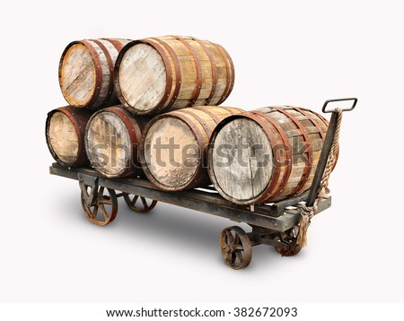 Old wooden wine barrels piled on a cart isolated in white background.