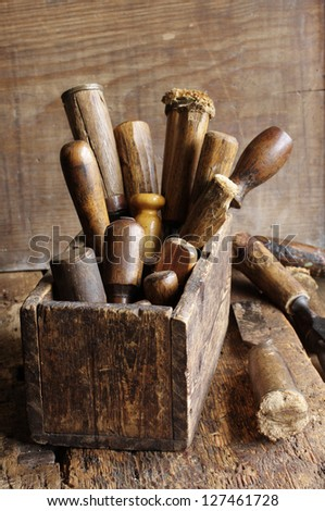 Old woodworking tools in a wooden box at workbench - stock photo