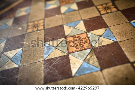 Old, word decorative Victorian floor tiles.
