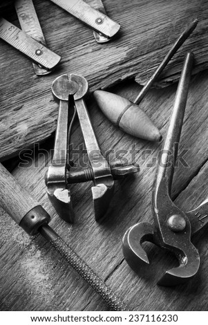 old work-table  of carpenter workshop with vintage tools, black & white image - stock photo