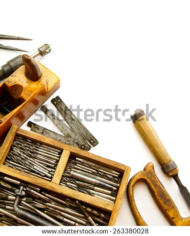 Old working tools. Vintage working tools (box with drills and others) on white background. - stock photo