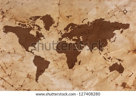 Old World map on creased and stained sepia coloured parchment paper. - stock photo