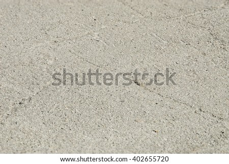 Old worn and cracked asphalt with cracks. Tilt shift effect - stock photo