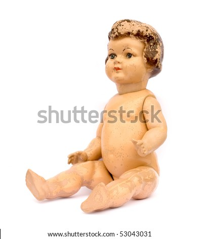 Old worn antique doll on white background. - stock photo