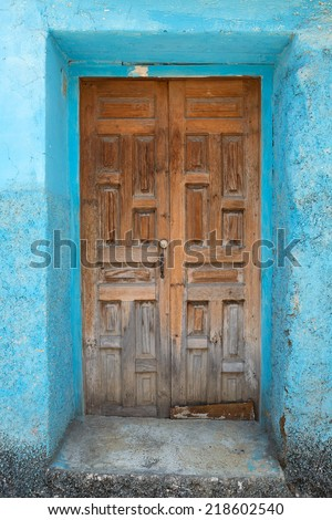 old worn entrance door in Mexico - stock photo