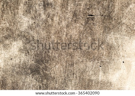 Old, worn-out concrete wall with black stains as creative background - stock photo
