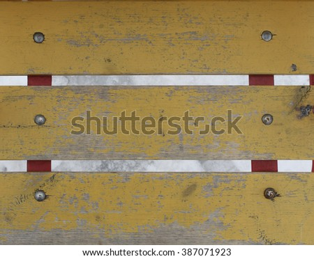 Old worn planks painted with yellow paint