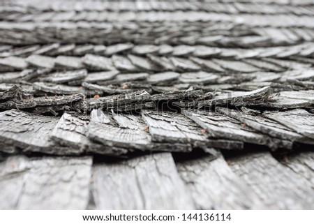 old worn wooden shingle roof pattern - close up - stock photo