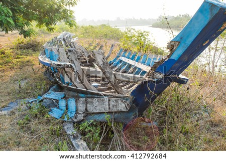 old wreck on land - stock photo