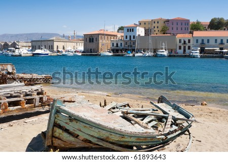 Old wrecked boat in harbor of Chania. Crete, Greece