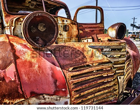 Old wrecked car on a junk yard - stock photo
