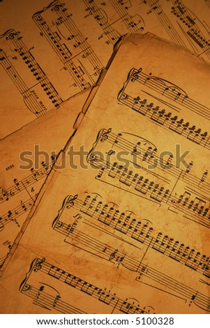 old wrecked piano sheet music - stock photo