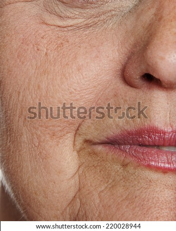 old wrinkled face close up - stock photo