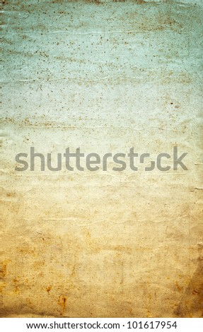 Old wrinkled paper with a vintage colored gradient, grunge stains, and grainy texture. - stock photo