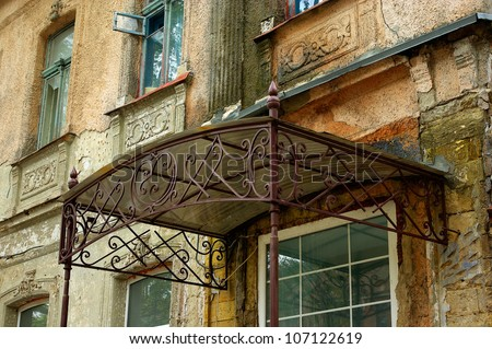 old wrought-iron canopy over the door of an old house & Old Wroughtiron Canopy Over Door Old Stock Photo 107122619 ...