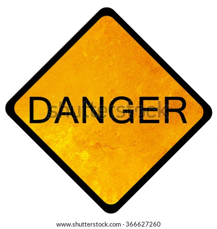 old yellow danger sign  - stock photo
