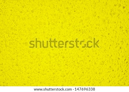 Old yellow dirty wall background or texture