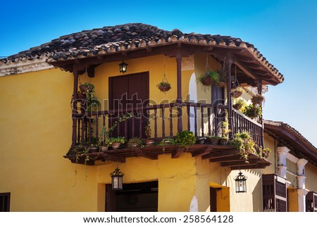 old yellow house on a sunny day - stock photo