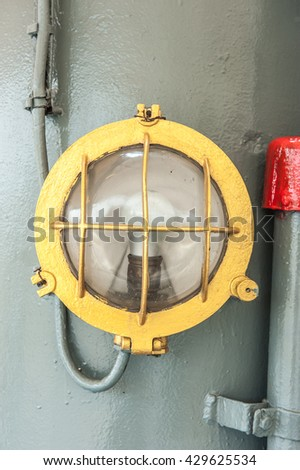 Old yellow lamp on the ship,close up.