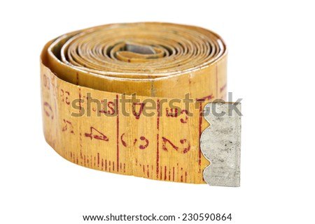 Old yellow measure tape isolated on white with clipping path - stock photo