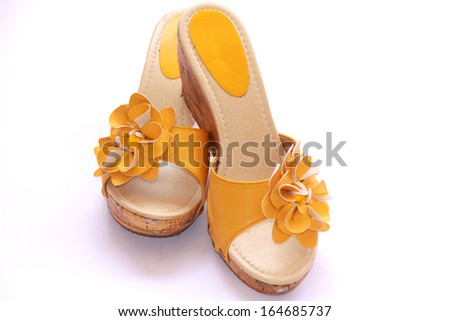 Old yellow shoes on a white background