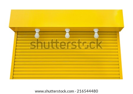 Old yellow steel door There are three light bulbs storefront. - stock photo