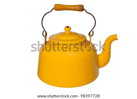 Old yellow tea pot isolated on white