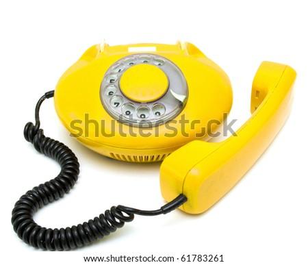 old yellow telephone - stock photo