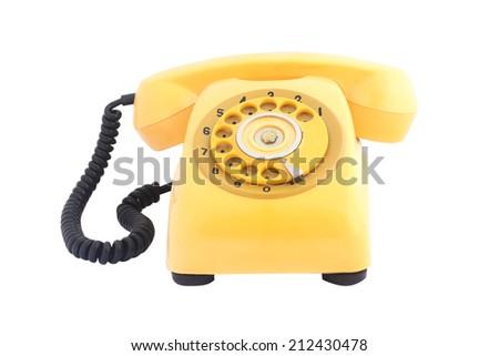 old yellow telephone isolate on white background - stock photo