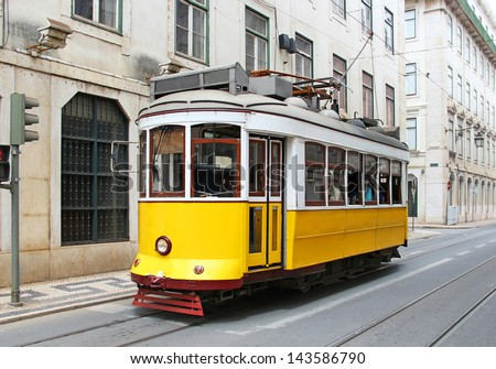 Old yellow tram in Lisbon downtown, Portugal - stock photo
