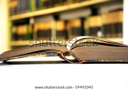 old yellow vintage books in library showing education concept - stock photo