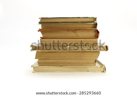 Old, yellowed books on a white background