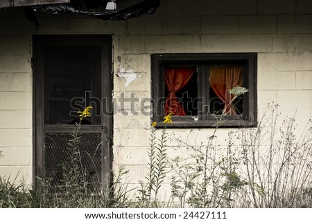 old yet colorful abandoned house - stock photo