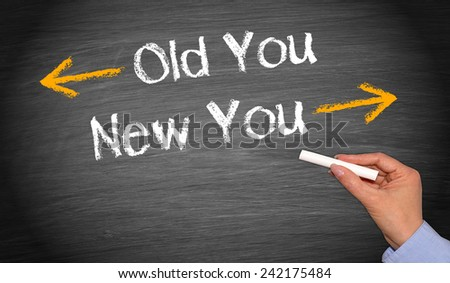 Old You and New You - female hand with chalk on blackboard background - stock photo