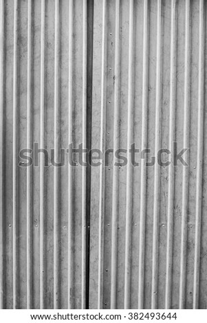 Old zinc plat wall for background and textured, vertical image - stock photo