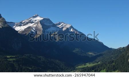 Oldenhorn in summer, high mountain near Gstaad - stock photo