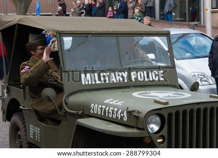 "OLDENZAAL, NETHERLANDS - APRIL 6, 2015: Military parade by ""keep them rolling"", a foundation who maintains military vehicles with the purpose of keeping the 2nd World War memories alive."