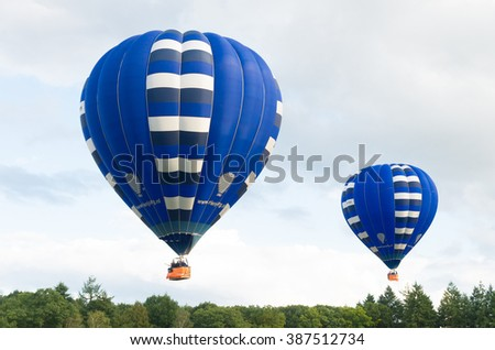 OLDENZAAL, NETHERLANDS - AUGUST 19, 2015: Hot air balloons taking off for an evening flight above the Netherlands - stock photo