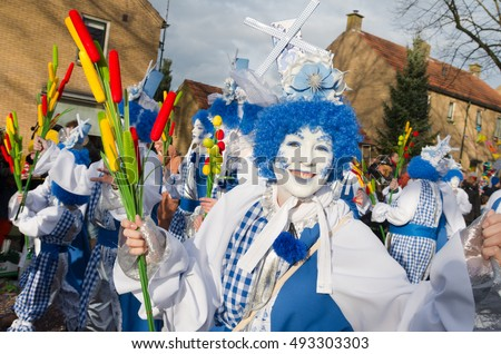 OLDENZAAL, NETHERLANDS - FEBRUARY 7, 2016: Unknown person in funny carnival outfit during the annual carnival parade
