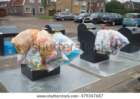 OLDENZAAL, NETHERLANDS - JANUARY 1, 2016: plastic bags with recyclable waste at a waste collection point