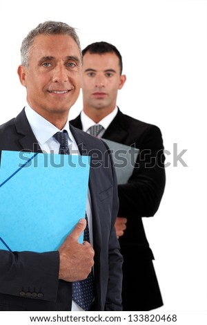 Older and younger businessmen - stock photo