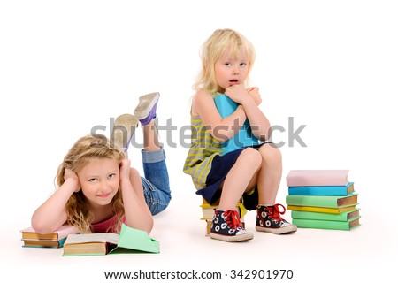 Older and younger sisters spend time reading books. Education. Isolated over white. - stock photo