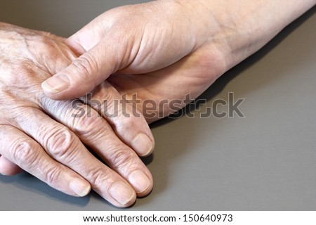 Older and younger woman's hands