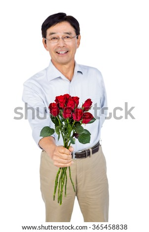 Older asian man offering roses on white background