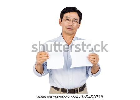 Older asian man showing ripped page on white background