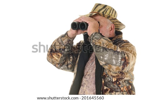 Older bearded hunter searching for game with binoculars, isolated on white with copy space - stock photo