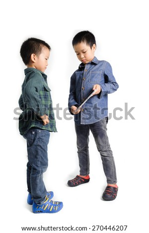 Older boy show cracked tablet device from fall to younger boy on white background